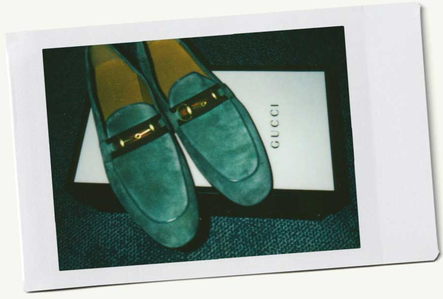 Polaroid of Gucci loafers