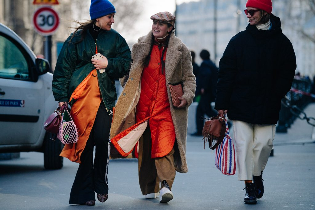A Photo of Three Women Wearing Hats Walking in Paris During Fashion Week