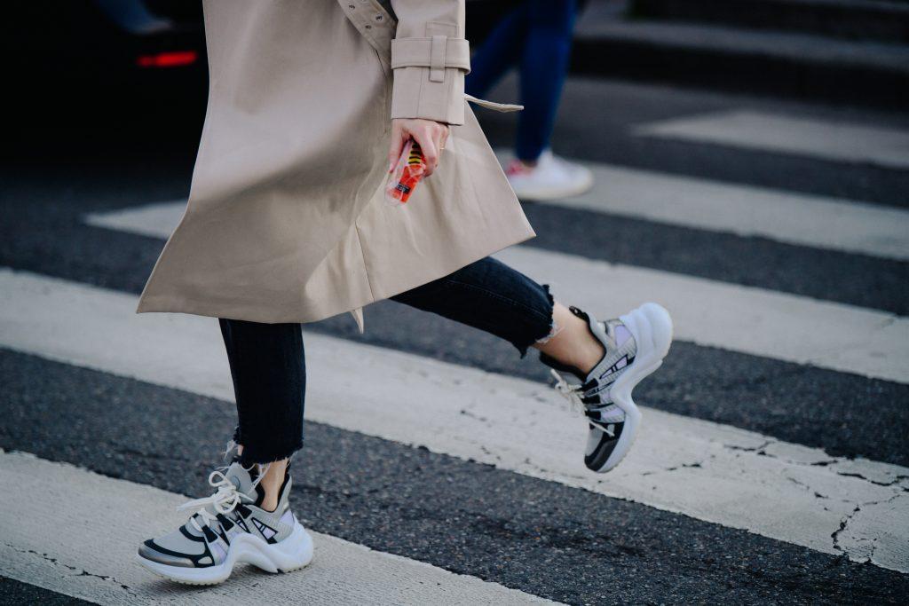 A Photo of a Woman Wearing Balenciaga Triple S Sneakers