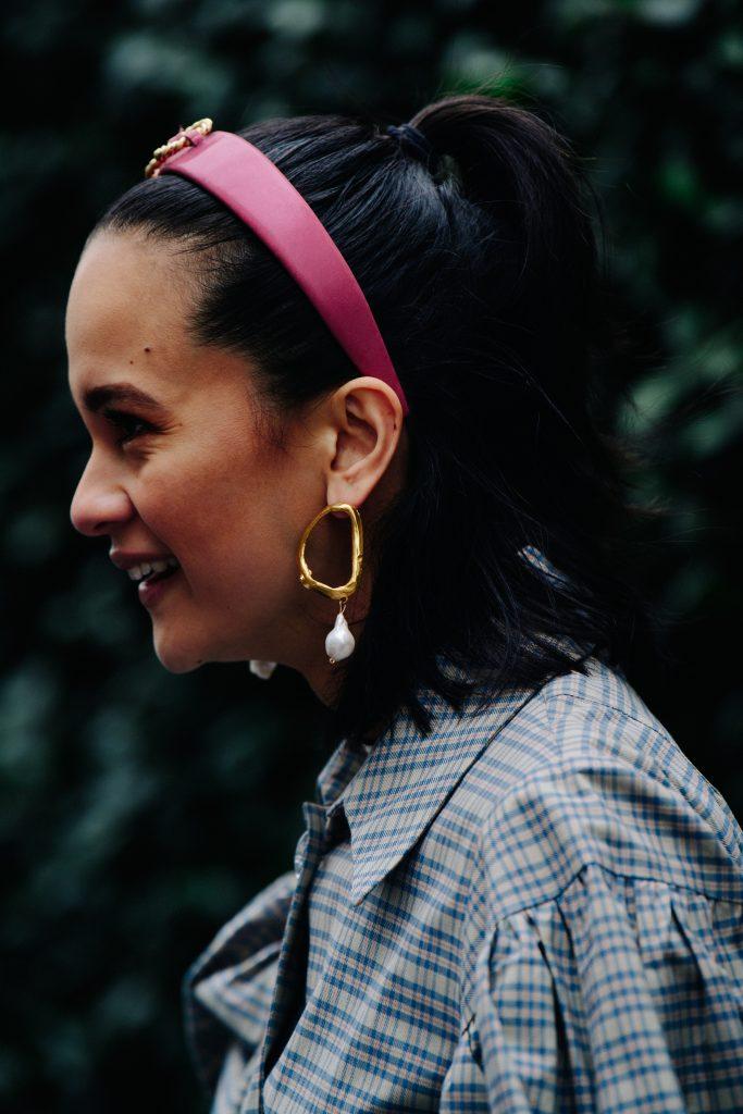 An Image of Woman Wearing Hoop Pearl Earrings During Fashion Week