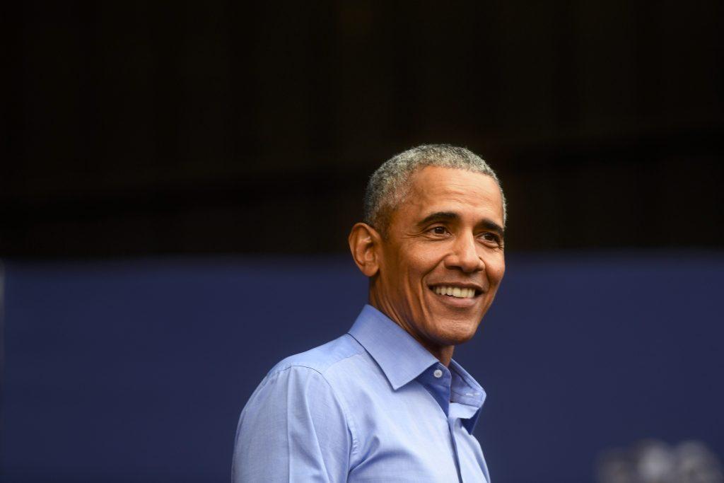 An Image of Barak Obama Wearing a Light Blue Shirt