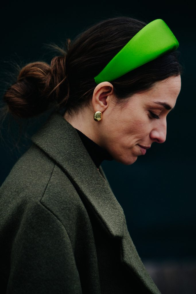 An Image of a Woman Wearing a Green Hair Band